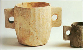 Measuring cups made of limestone, apparently used for ceremonial washing of hands.